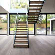 U shaped double beams straight staircase indoor  with glass railing